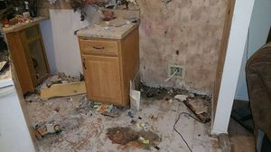 Water Damage Fire Damage Kitchen Area With Restoration In Progress