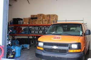 Water Damage Restoration Van Parked At Headquarters